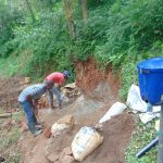 The Water Project: Bumira Community, Imbwaga Spring -  Mixing Cement