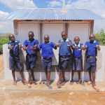 The Water Project: Mukama Primary School -  Boys Pose With Their New Latrines