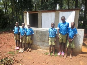 The Water Project:  Boys Stand With New Latrines