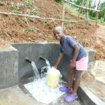 The Water Project: Malimali Community, Shamala Spring -  Fetching Clean Water