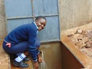 The Water Project:  Happy Student With The Rain Tank
