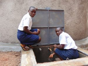 The Water Project:  Girls At The Rain Tank Tap