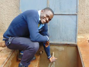 The Water Project:  Happy Pupil At The Rain Tank