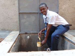 The Water Project:  Student Getting A Drink