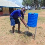 The Water Project: Mukama Primary School -  Students Uses A Handwashing Station