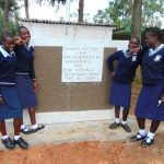 The Water Project: Kerongo Secondary School -  Girls Pose With Their New Latrines