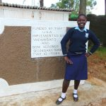 The Water Project: Kerongo Secondary School -  A Student In Front Of The New Girls Latrines
