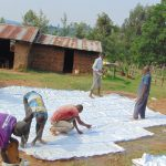 The Water Project: Kosiage Primary School -  Tying Sugar Sacks To Wire Mesh For Dome Skeleton