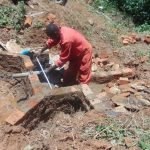 The Water Project: Kisasi Community, Edward Sabwa Spring -  Setting The Pipe In The Headwall
