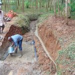 The Water Project: Shivembe Community, Murumbi Spring -  Adding Concrete To Foundation