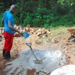 The Water Project: Kimarani Community, Kipsiro Spring -  Mixing Cement