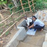 The Water Project: Buyangu Community, Mukhola Spring -  Joining The Smiles