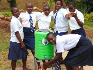 The Water Project:  Girls With A Handwashing Station