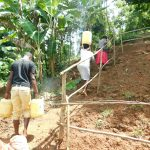 The Water Project: Malimali Community, Shamala Spring -  Heading Home With Clean Water