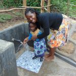 The Water Project: Buyangu Community, Mukhola Spring -  Christine With A Child