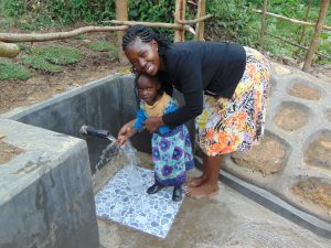 The Water Project:  Christine With A Child