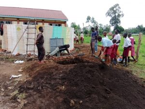 The Water Project:  Shoveling Dirt Into Soak Pit