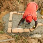 The Water Project: Malimali Community, Shamala Spring -  Measuring And Setting Bricks