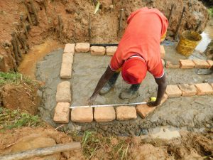 The Water Project:  Measuring And Setting Bricks