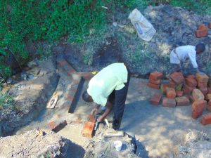The Water Project:  Bricklaying On The Foundation