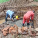 The Water Project: Bumira Community, Imbwaga Spring -  Bricklaying Begins Over Foundation