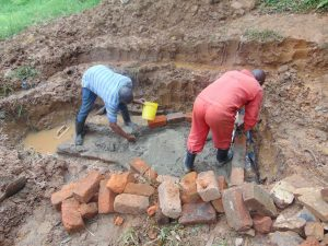 The Water Project:  Bricklaying Begins Over Foundation