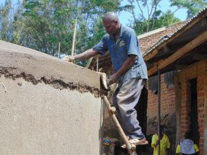 The Water Project:  Artisan Works On Dome Cement