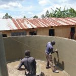 The Water Project: Mukama Primary School -  Central Support Pillar And Tank Receive Plaster