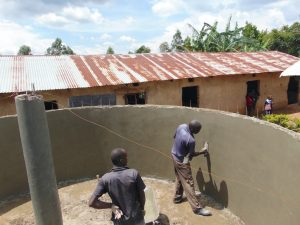 The Water Project:  Central Support Pillar And Tank Receive Plaster