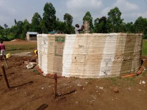 The Water Project:  Artisan Secures Central Support Pillar