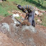 The Water Project: Jivovoli Community, Magumba Spring -  Mixing Cement