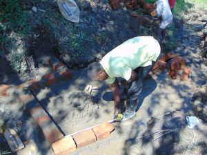 The Water Project:  Measuring Early Brick Work