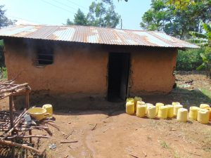 The Water Project:  Water Containers Outside Kitchen