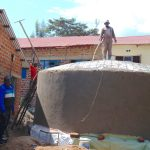 The Water Project: Banja Secondary School -  Handing Dome Support Pole To Artisan