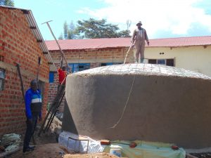 The Water Project:  Handing Dome Support Pole To Artisan