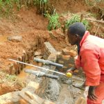 The Water Project: Malimali Community, Shamala Spring -  Setting Discharge Pipes
