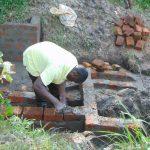 The Water Project: Buyangu Community, Mukhola Spring -  Wall Construction