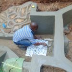 The Water Project: Kisasi Community, Edward Sabwa Spring -  Tile Setting