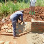 The Water Project: Shikhombero Community, Atondola Spring -  Rub Wall Construction