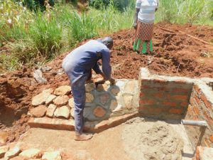 The Water Project:  Rub Wall Construction