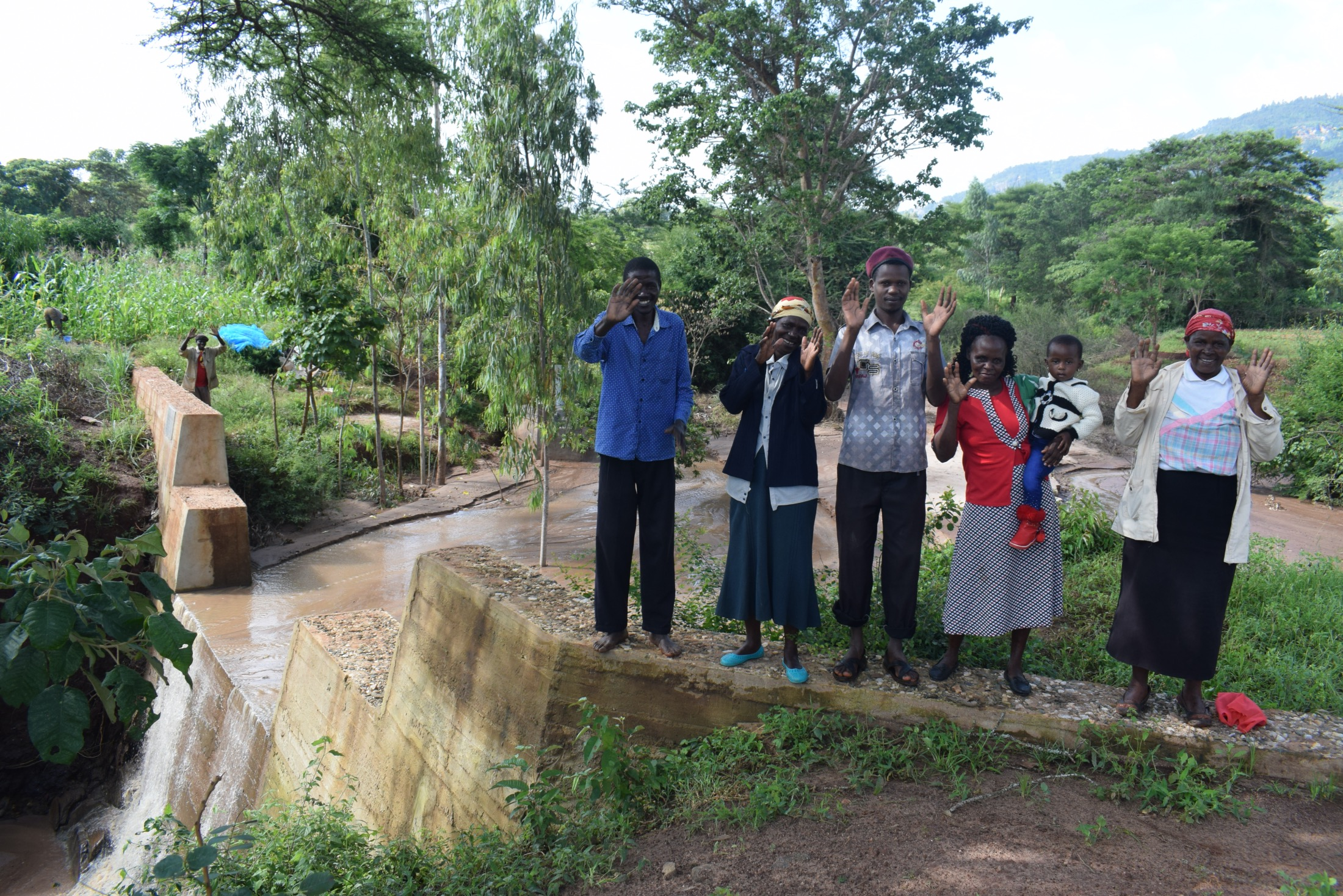 The Water Project : kenya19200-community-members-at-the-dam