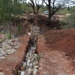 The Water Project: Utuneni Community B -  Filling Wing Wall Trenches