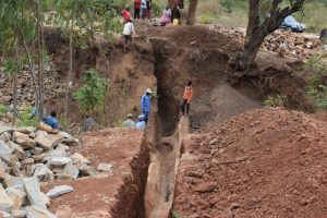The Water Project:  Trenching For Dam Wing Walls