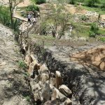 The Water Project: Kithumba Community D -  Trenching For Wing Walls
