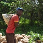 The Water Project: Kaketi Community -  Carrying Cement