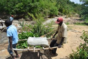 The Water Project:  Carrying Cement Bag
