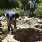 The Water Project: Kaketi Community A -  Laying Bricks