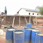 The Water Project: AIC Mbao Primary School -  Barrels Filled With Water For Mixing Cement