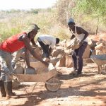 The Water Project: AIC Mbao Primary School -  Loading Up Rocks For Construction