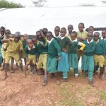 The Water Project: AIC Mbao Primary School -  Students In Front Of Their Tank